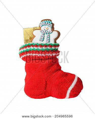 Christmas stocking with gingerbread cookie and gift isolated on white background