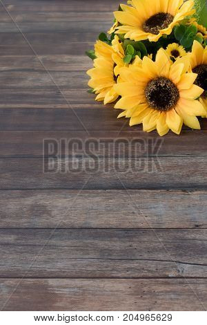 Sunflower Bouquet on dark brown wooden background with lots of copy space.