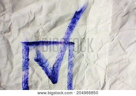 Blue check mark on crumpled paper background. Voting process with copy space
