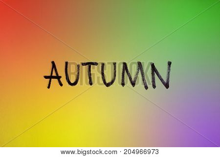 Colorful autumn sign. Word hand made on different colors background