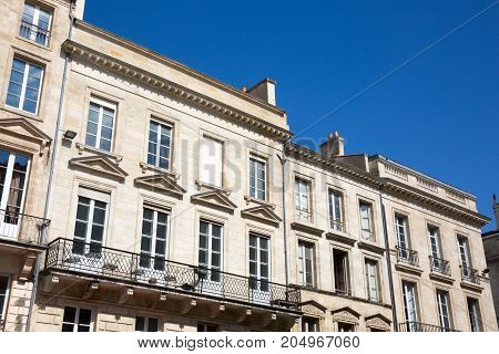 Traditional French Architecture With Typical Windows And Balconies In Paris, France. Haussmann Renov