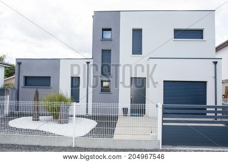 Beautiful new design Cozy modern single house with garage with wide lawn and stone driveway external view