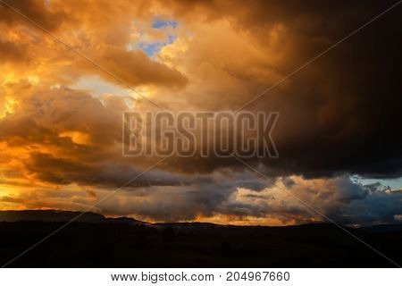 Dark storm clouds before rain at sunset. cloud on sunset for background