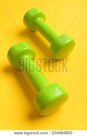 Barbells In Small Size Made Of Plastic. Healthy Lifestyle Concept