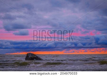 a coloured the sky above the sea with a stone