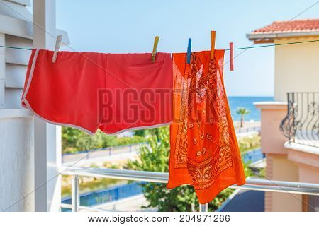 Bandana And Shorts Hang On A Rope In The Street