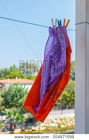 Bandanas Hang On A Rope In The Street