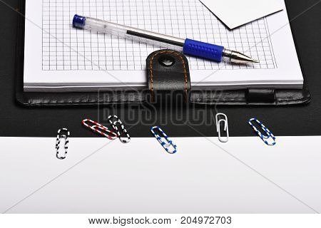 Organizer And Pen On Black And White Background, Close Up