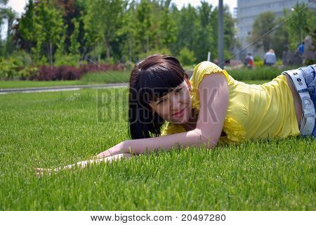 Portrait Of A Beautiful Girl On Grass