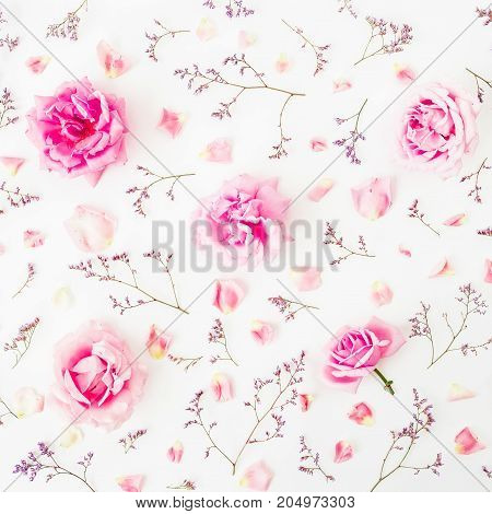 Floral pattern with pink roses, wild flowers and petals on white background. Flat lay, Top view. Roses background.