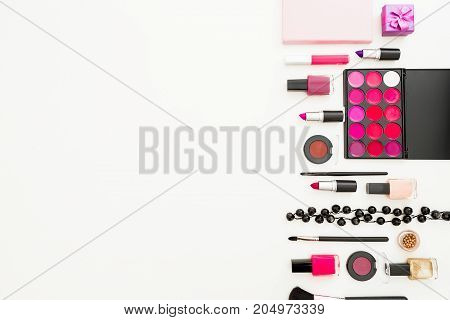 Feminine desk with woman cosmetics and accessories on white background. Flat lay, top view. Beauty background