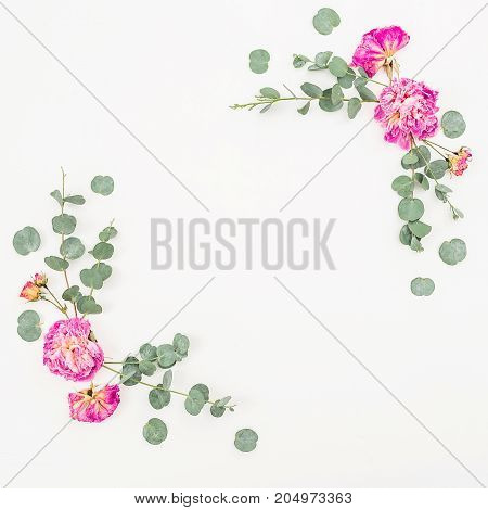 Floral frame of pink roses and eucalyptus on white background. Flat lay, top view. Valentines background