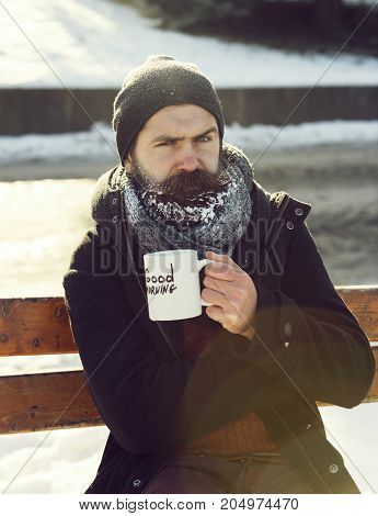 Frown Man Drinks From Cup