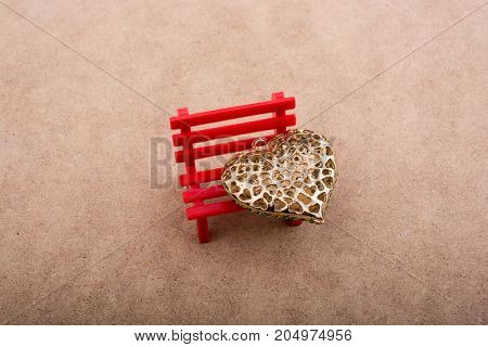 Heart Shaped Object On Red Bench