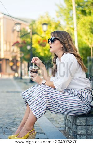 Girl With Coffee To Go On The Street