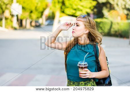 Girl Calling Taxi On The Street