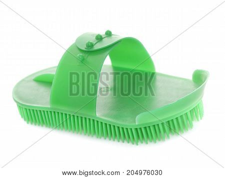 green currycomb in front of white background