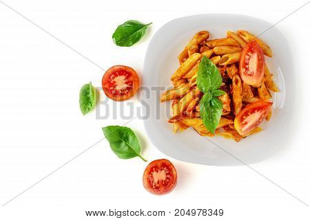 Penne pasta with bolognese sauce, tomato and basil on plate isolated