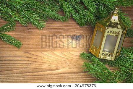Golden christmas lantern lamp laying in fir tree branches on burnt wooden board surface background with copy space. Christmas decorations.