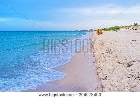 The sandy coast of El Kantaoui is the best place to relax and walk along the sea enjoying the sunset Tunisia.
