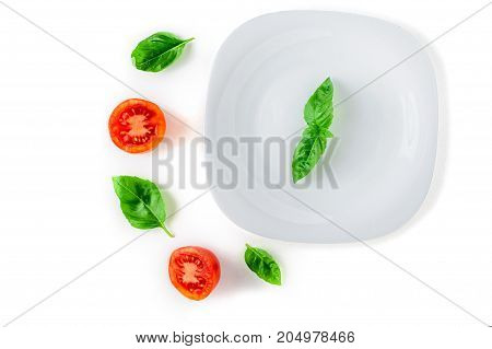 the concept of healthy and proper nutrition. Tomato, basil on white background isolated