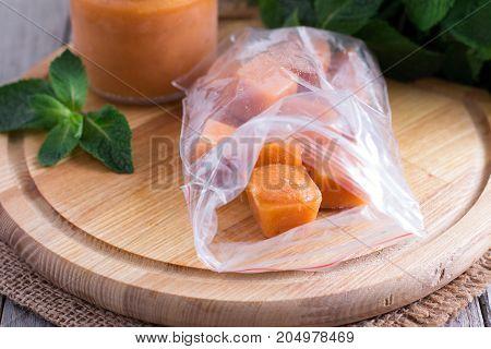 Fruit frozen cubes in a plastic bag