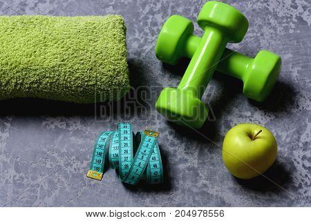 Tape Measure And Fruit Near Barbell. Workout And Healthy Lifestyle