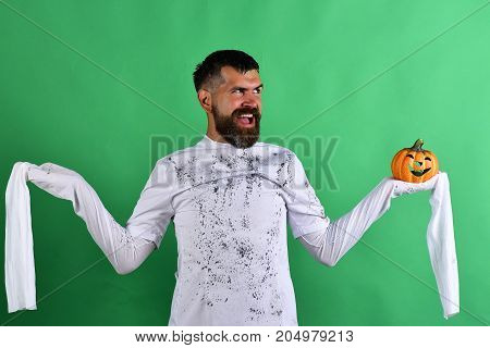 Man With Evil Face Expression On Green Background