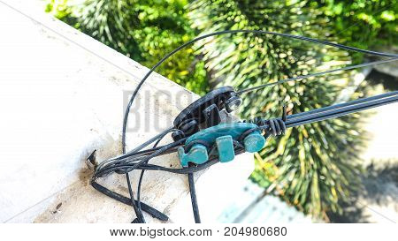 2 VS company tool equipment Fiber optic line WIFI at home macro photo focus select at object background plam tree are blur.