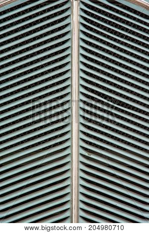 Background of vintage car grill mesh. Automobile theme.