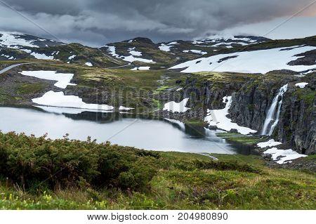 Waterfall in the mountains along the National tourist route Aurlandstjellet. Flotane. Bjorgavegen. Western Norway