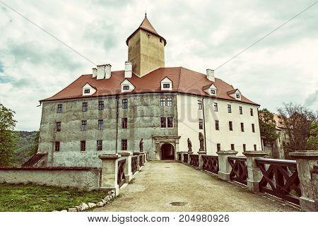 Famous Veveri castle Moravia Czech republic. Ancient architecture. Travel destination. Retro photo filter.