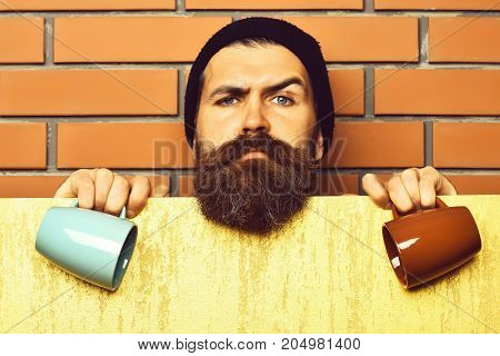 Bearded Brutal Caucasian Hipster With Paper Sheet And Cups