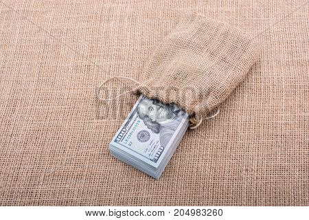 Banknote Bundle Of Us Dollarin A Sack