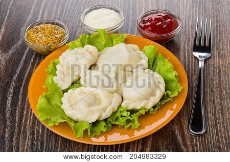 Boiled Dumplings With Lettuce, Bowl With Horseradish, Mustard, Ketchup