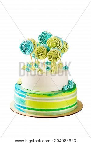 Tiered Green And Blue Birthday Cake Isolated On White