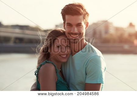 Portrait of beautiful young couple in love standing outdoor.