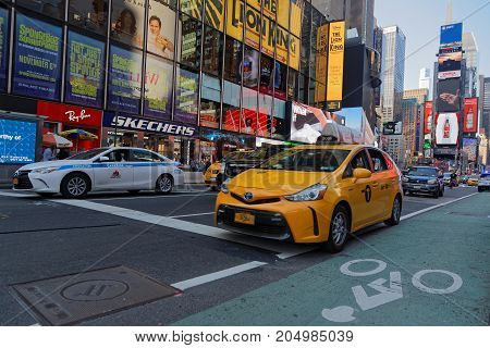 New York City, Usa, September 10, 2017 : Taxi In Times Square. Times Square Is A Major Commercial In