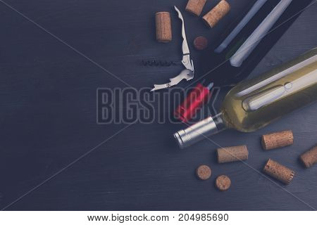 Bottles of red and white wine with corks on table, retro toned