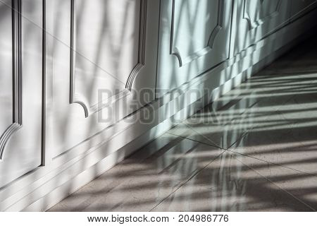 light and shadow pattern on white panel furniture