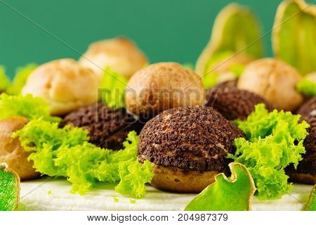 Chocolate Cream Puffs With Green Decoration