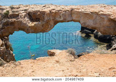 Stone bridge in the park of Cavo Greco close