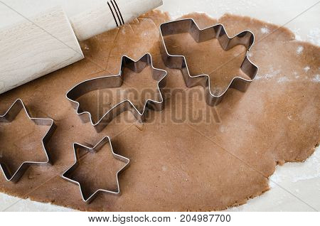 Cooking Christmas cookies. Gingerbread dough with spice. Forms for Christmas cookies gingerbread rolling pin cutter.