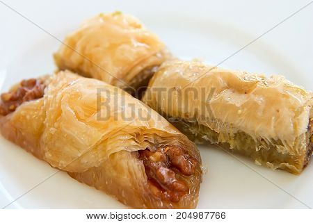 Turkish baklava on a white plate - close-up
