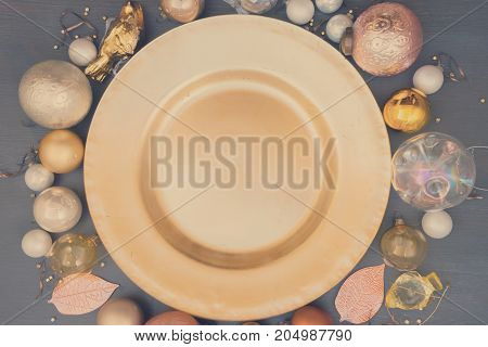 Christmas empty golden plate with gold decorations, retro toned