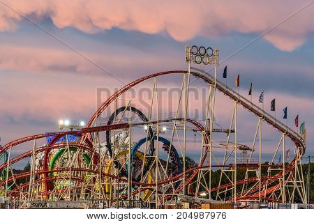 MUNICH GERMANY - 16 OCTOBER 2017: View of the famous Olympia looping roller coaster in Oktoberfest during sunset