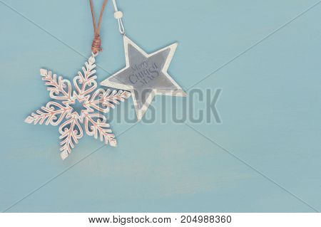 Blue and white christmas with stars on blue wooden background, retro toned