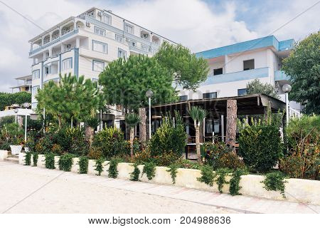 ALBANIA GOLEM- September 20 2015: Guest apartment buildings are surrounded by different plants in the resort area of Golem on the Adriatic coast.