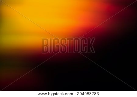 Abstract background of blurred orange and red light blur. Bokeh of defocused lines in motion, aurora skylights wallpaper, magic of nature around