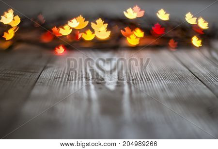 Autumn Maple Leaf Bokeh On Wooden Background